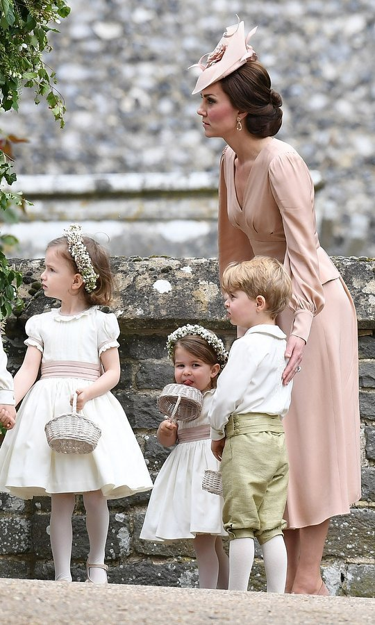 She's usually the centre of attention but on this occasion Duchess Kate played a supporting role, helping to keep the wedding on track.