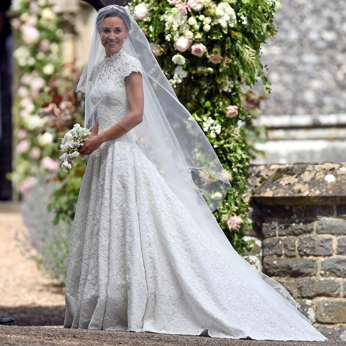 Pippa wore a floor-length Giles Deacon dress, with a long train and delicate veil, and had her brunette hair swept up into an elegant chignon. She was the picture-perfect romantic bride for the English countryside nuptials.
