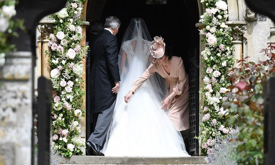 The bride's sister, the Duchess of Cambridge, helped her adjust her train – just as Pippa had done for her during her royal wedding in 2011.