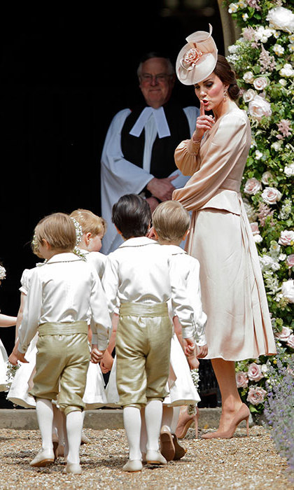 In her supporting role, Duchess Kate kept the cute little pageboys and flower girls in line, including her own 3-year-old Prince George and 2-year-old Charlotte.