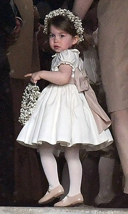 Prince William and Kate's daughter Princess Charlotte was adorable bearing flowers with a matching garland in her hair. 