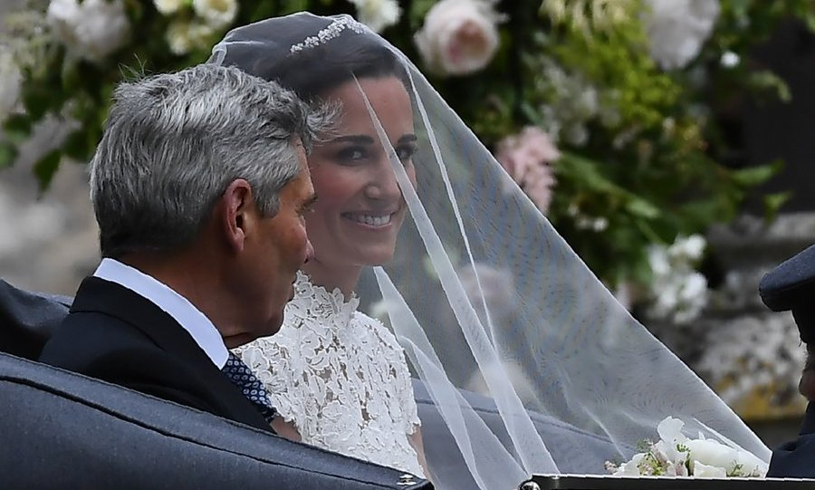 Pippa was stunning in an appliqué lace dress with cap sleeves and a delicate veil held in place over a small tiara.