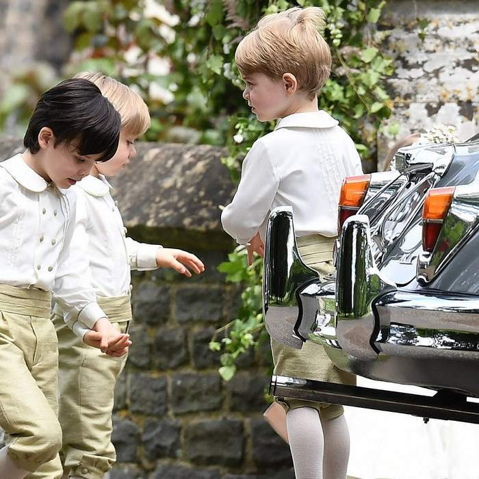 Before their big moment, Prince George and his fellow pageboys waited patiently together outside the church.