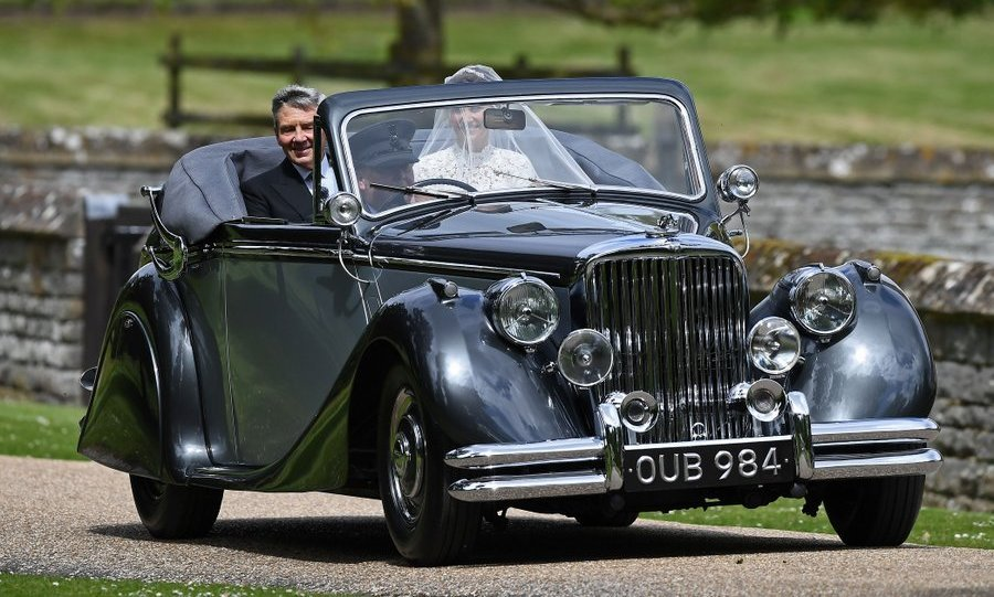 The radiant bride arrived in style in a vintage car driven by her father, Michael Middleton.