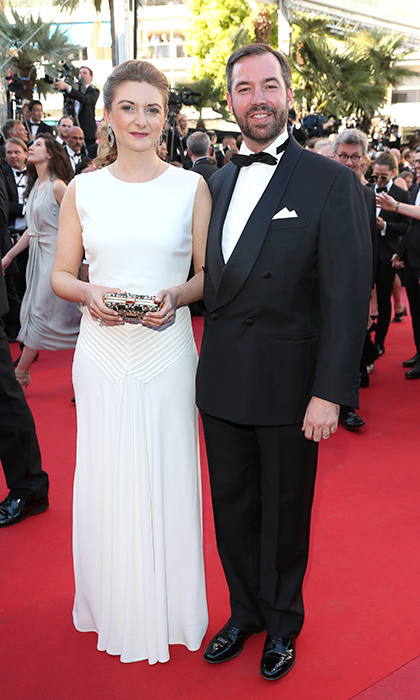 Wearing a white sleeveless Ralph Lauren gown, Princess Stephanie of Luxembourg stepped out with husband Prince Guillaume for the opening night screening of Ismael's Ghosts (Les Fantomes d'Ismael) at the 70th annual Cannes Film Festival. 
