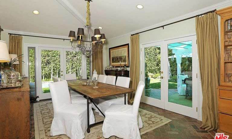 The 3,188 square foot property has a large dining room with double patio doors that lead to another seating area, a built-in barbecue and garden. It currently features the same brick floor and neutral walls that run through the kitchen and living room area, with plenty of space for entertaining.