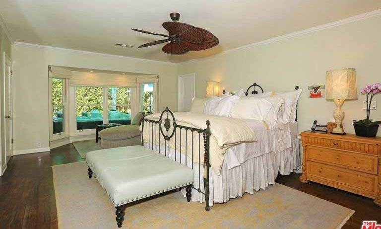 The main house has three bedrooms including this master bedroom, which has a large bay window overlooking the garden. The master suite has two spacious walk-in wardrobes as well as two normal-sized wardrobes for Selena to store her enviable fashion collection. 