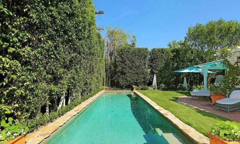 The large garden at the Studio City property has a stone-edged swimming pool and spa, as well as brick patios with an outdoor seating area, built-in barbecue area and fruit trees and vegetable beds.
