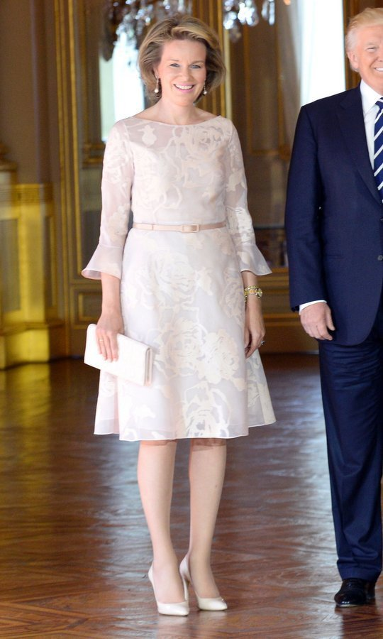 Queen Mathilde of Belgium was pretty in pastel pink as she greeted President Donald Trump and First Lady Melania Trump at the Royal Palace in Brussels.
