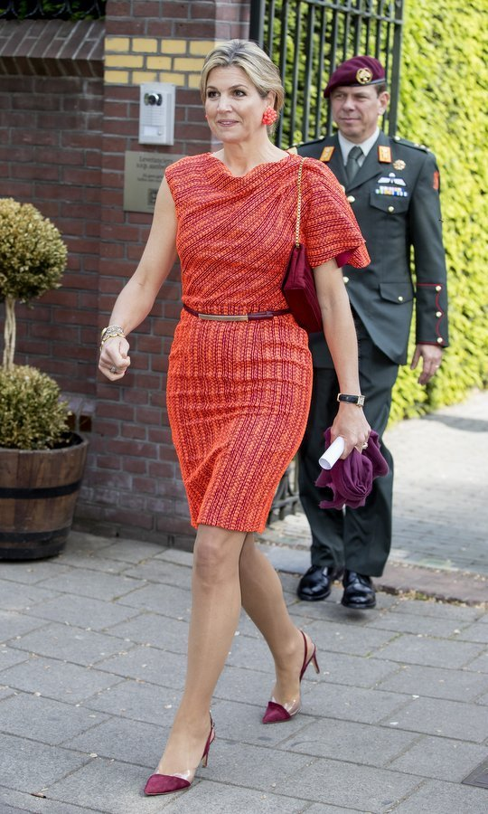 Queen Maxima of the Netherlands showed off her famed colourful style as she attended the Wijzer Symposium in Amsterdam.