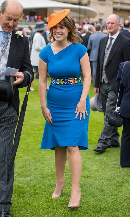 We're loving Princess Eugenie's colourful outfit and funky belt, worn to a garden party at Buckingham Palace.