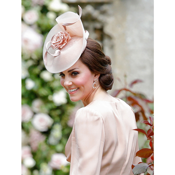 At her sister Pippa Middleton's wedding on May 20, Kate paired her blush Alexander McQueen gown with a matching hat creation by Jane Taylor. 