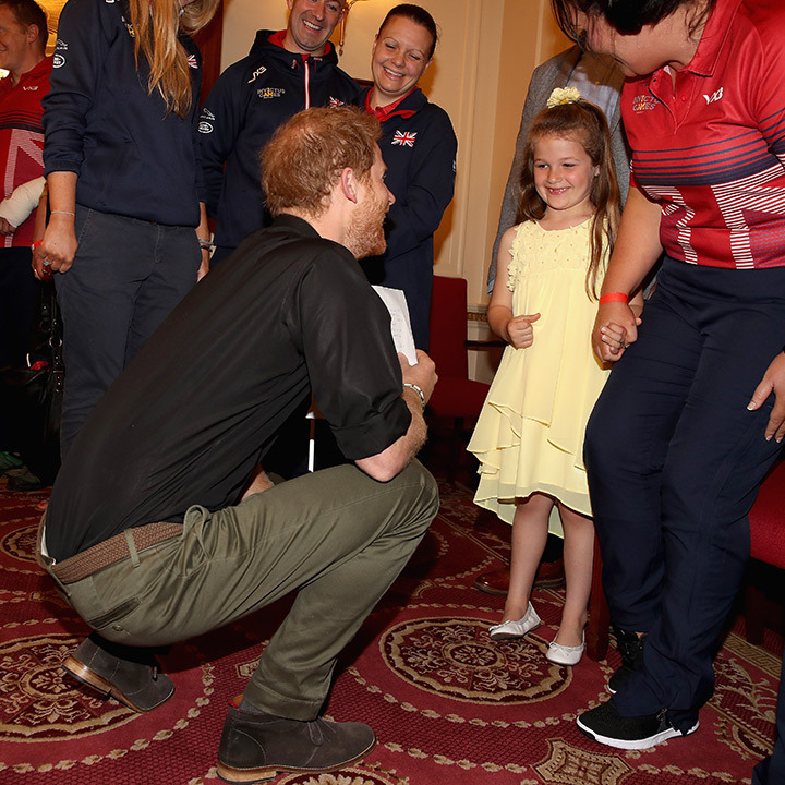 Harry shared a special moment with six-year-old Maya Turner at an Invictus Games event in London on Tuesday (May 30). The youngster wrote a thank you letter to the prince for 'helping her mummy' by selecting her to compete at the games in Toronto in September. 
