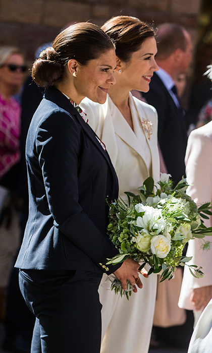 Crown Princess Victoria of Sweden, left, and Crown Princess Mary of Denmark showed they're both pantsuit fans as they visited the store Ole Lynggaard Copenhagen on May 29 in Stockholm.