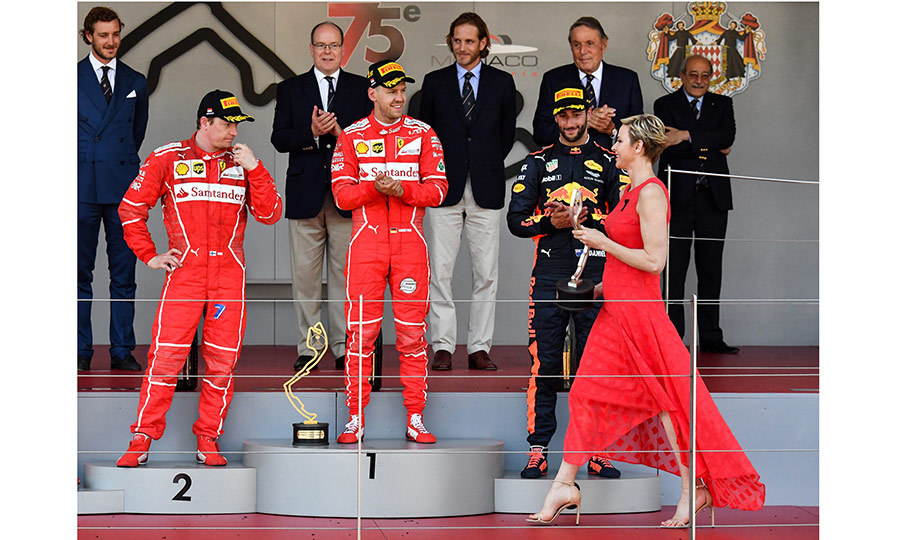 Wearing a red maxidress, Princess Charlene was a fashion winner as she awarded the champions of the Formula One race in Monte-Carlo.