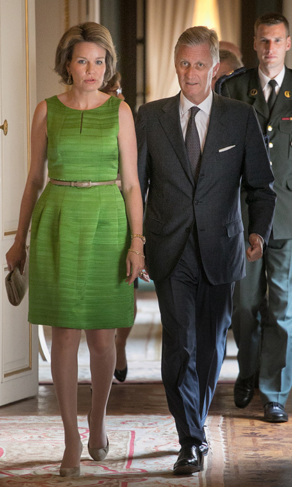 Queen Mathilde of Belgium, with husband King Philippe, wore spring green for a lunch in Brussels.