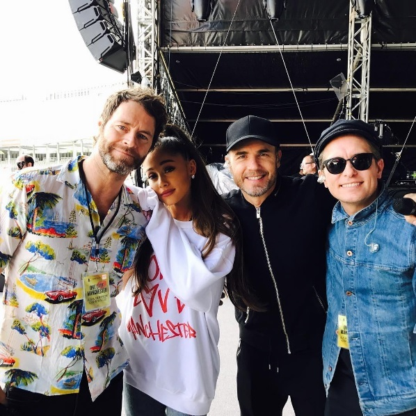 "Ariana was joined backstage by the British band Take That as preparations and sound checks for the concert were underway on Sunday. The singer, who was wearing a One Love Manchester sweatshirt, stood with Manchester locals Gary Barlow, Mark Owen and Howard Donald for the photo at the Emirates Old Trafford. Gary later posted the photo on his Instagram account, simply adding the caption: ""#onelove #manchester.""