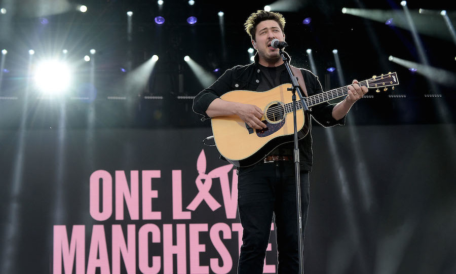 "The show opened with a performance from Mumford and Sons lead singer Marcus Mumford, who led the crowd in a minute's silence before performing an acoustic version of the band's song Timshel for the 50,000 strong crowd. With lyrics that included the words, ""You are not alone in this"" it was a poignant start to the concert.