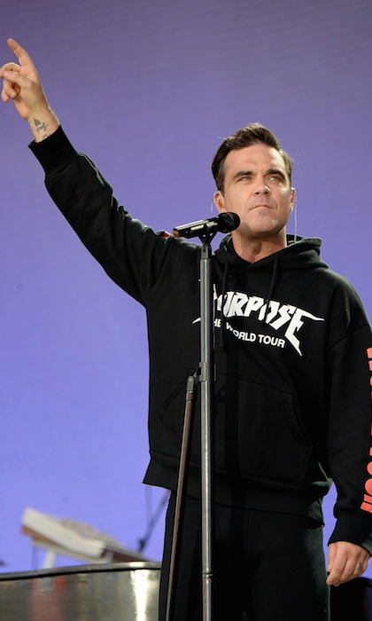 "Robbie Williams changed some of the lyrics to his hit song ""Strong"" to ""Manchester we're strong, we're still singing our song"" before struggling to get through his emotional ballad ""Angels,"" often looking to the crowd to sing the verses.