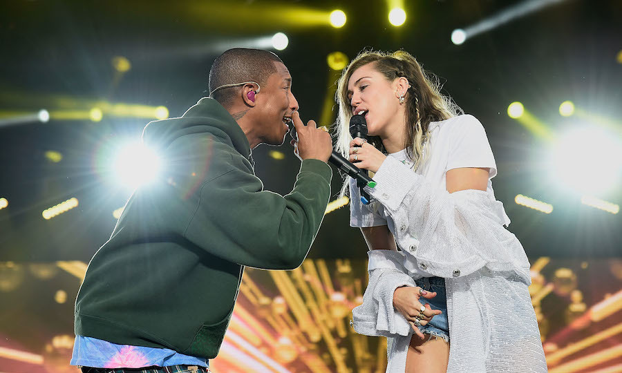 "Pharrell invited Miley Cyrus on stage to help him belt out his song ""Happy."" Miley said she was ""honoured"" to have been invited to perform at the benefit concert, and praised Ariana for being an ""amazing role model"" to her fans and arranging the concert to help all of those who had been affected by the attack.