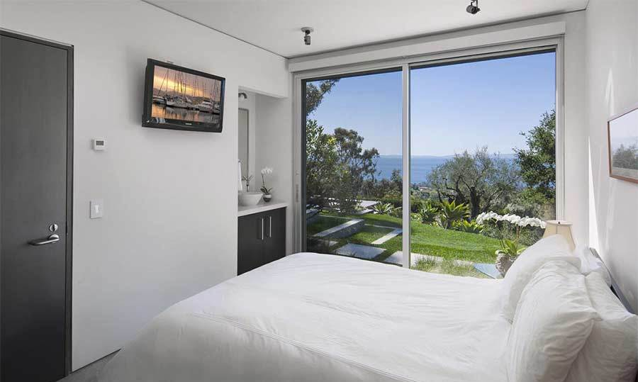 Natalie's new property has four bedrooms, including this small guestroom which features a double bed and direct access on to the home's 10.4 acres of gardens via a glass patio door. The room would be ideal for Natalie and Benjamin's guests, or could be converted for the actress' two children Aleph and Amalia.