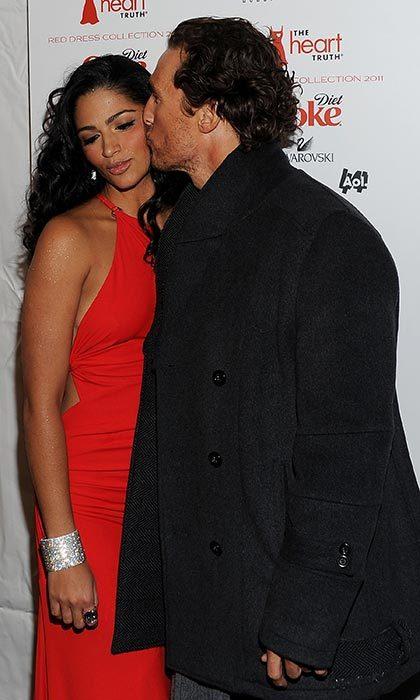 Matthew gave his long-time love a big smooch on the cheek at the Heart Truth's Red Dress Collection party during NY Fashion Week in February 2011.