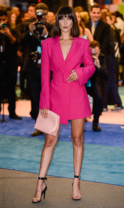 Bella Hadid was looking leggy wearing a pink belted jacket dress by Off-White.