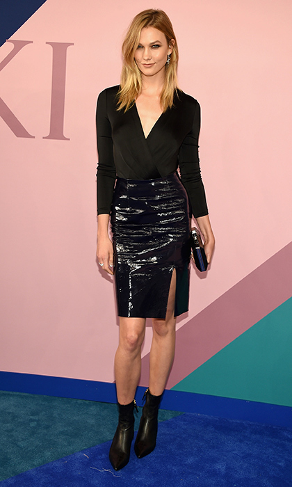 Karlie Kloss shows black is anything but basic in a wrap top and shiny pencil skirt by Diane von Furstenberg.