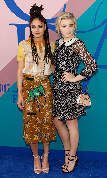 Sasha Lane, left, and Chloe Grace Moretz, both wearing looks by Coach 1941.