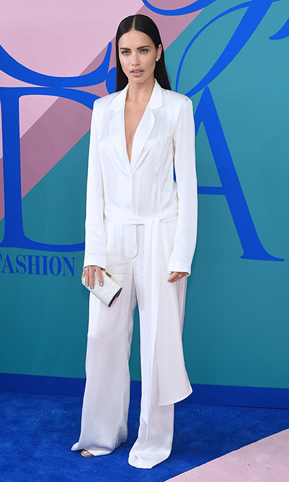 Adriana Lima showed the pajamas trend is going strong is a silky white jumpsuit by Urban Zen.