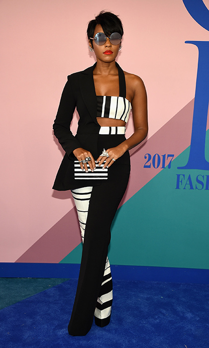 Janelle Monae wearing a pantsuit in her signature black and white by Christian Siriano.