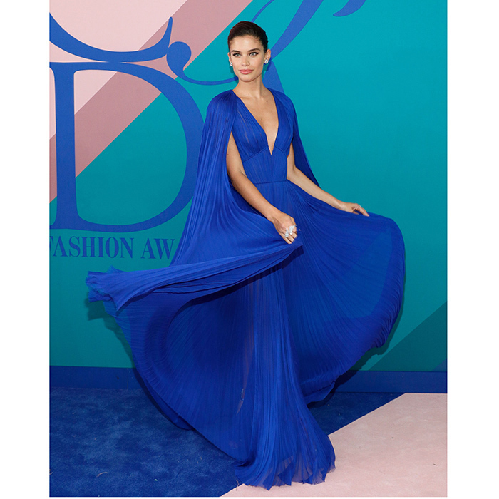 Sara Sampaio definitely would win the award for Best Twirl in her electric blue caped goddess gown by J Mendel.
