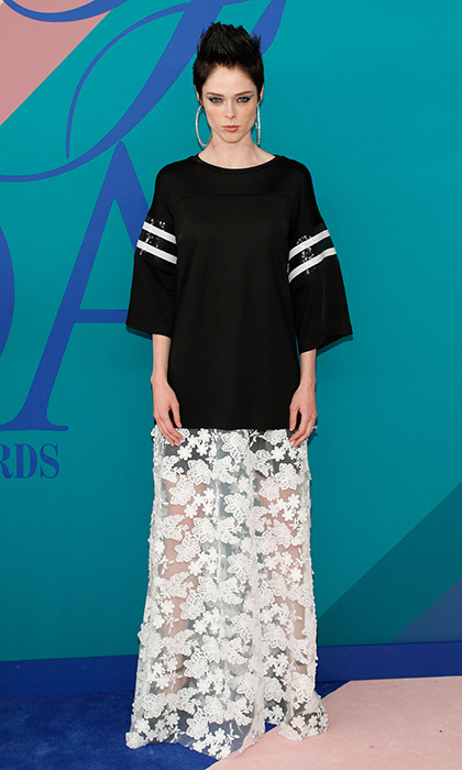 Coco Rocha went for sports luxe in a stripe-sleeved top and lace floor length skirt.