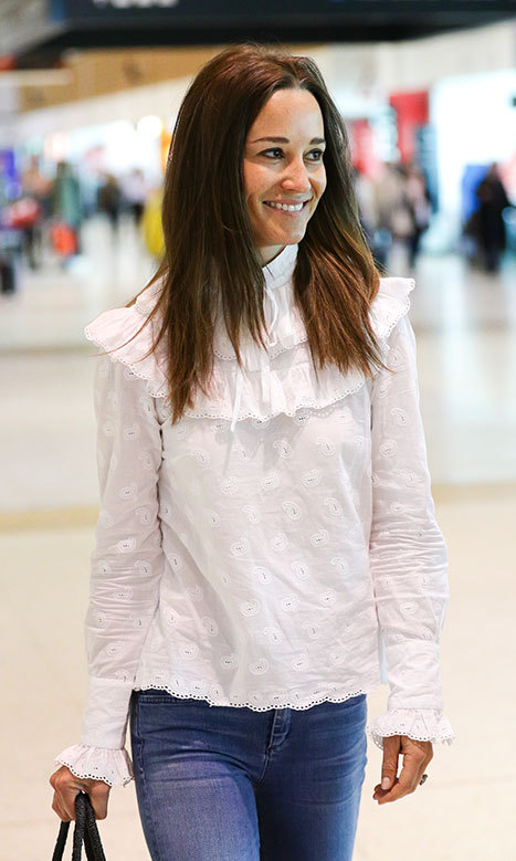 The 33-year-old wore her white Orla Kiely blouse with skinny jeans and her SensiStudio basket bag