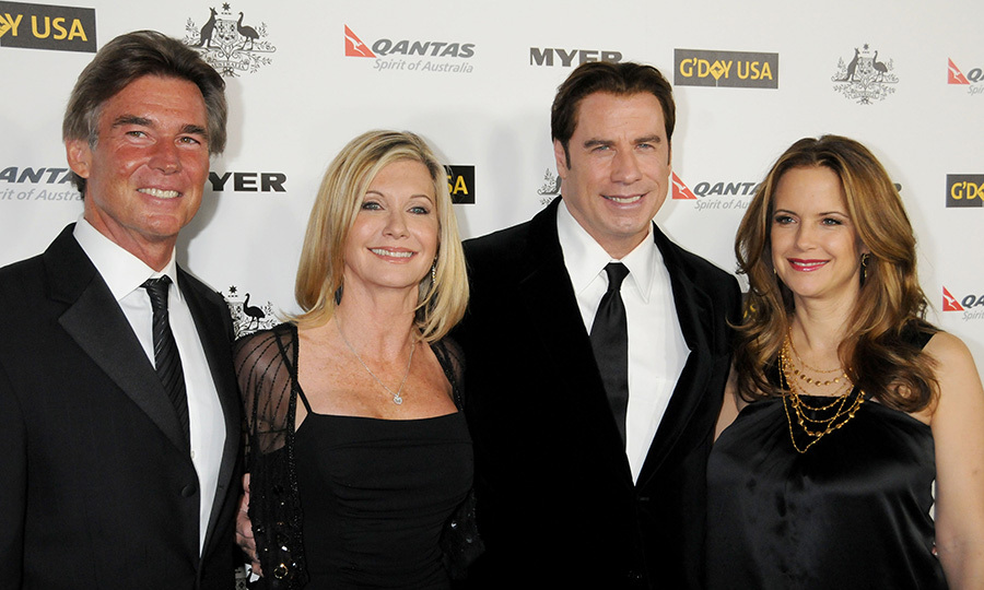 John and Olivia with their partners Kelly Preston and John Easterling.
