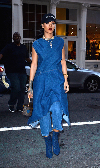Rihanna puts her own spin on the CT in a denim dress and over-size jeans.