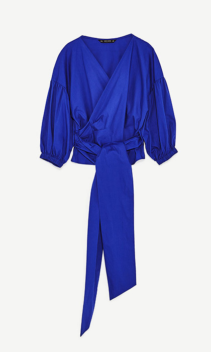 <p><strong>Crossover Blouse in Bluish</strong>, $40, <em>zara.com</em></p>