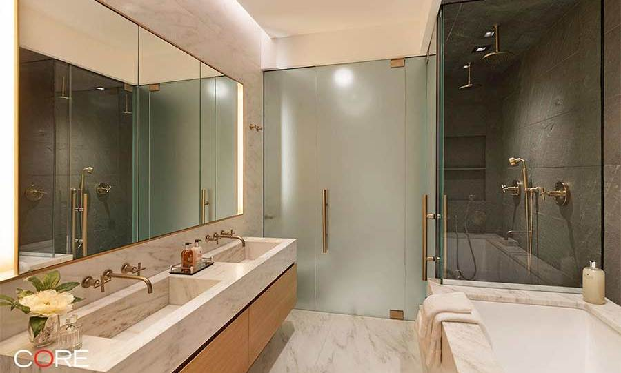 <p>This huge en-suite bathroom is the ideal pampering space for Diane, who often attends high profile red carpet events and premieres. As well as a large bathtub and wet room, the marble-lined room has a double sink and gold taps and fixtures for a luxurious finishing touch.</p>