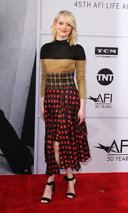 After taking a break from the red carpet, Emma Stone made a fun and flirty return to the spotlight on June 9 at AFI's 45th Life Achievement Award Gala in celebration of Diane Keaton. The Oscar winner looked beautifully busy in a dress by Loewe.