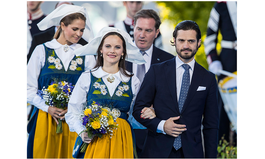 Swedish princesses Sofia, front, and Madeleine, behind, were escorted by their husbands – Prince Carl-Philip and Christopher O'Neill, respectively – in style during the country's National Day festivities.