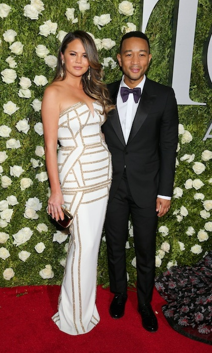 Chrissy Teigen won major fashion points in a strapless column dress by Pamella Roland. Her husband John Legend looked equally stunning in a black tux. 
