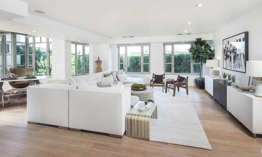 The property has a spacious open-plan design with wooden flooring running throughout. The living area is filled with a large L-shaped sofa and chairs, ideal for if Kendall is entertaining friends or her famous siblings. The room has dual aspect views out onto trees and greenery, meaning it is a private space where Kendall can relax without being overlooked.