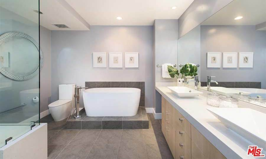 "Kendall's spacious 'starter home' has three bathrooms. This master bathroom suite is fitted with a free-standing bathtub and separate shower cubicle, with toilet and double basin area that has plenty of space for the model's beauty products and ""glam squad"" should she ever be getting red-carpet ready at this apartment.  