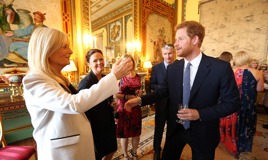 Prince Harry meets Gaby Roslin as he hosts a reception at Buckingham Palace to mark the 40th anniversary of the children's charity WellChild at Buckingham Palace.