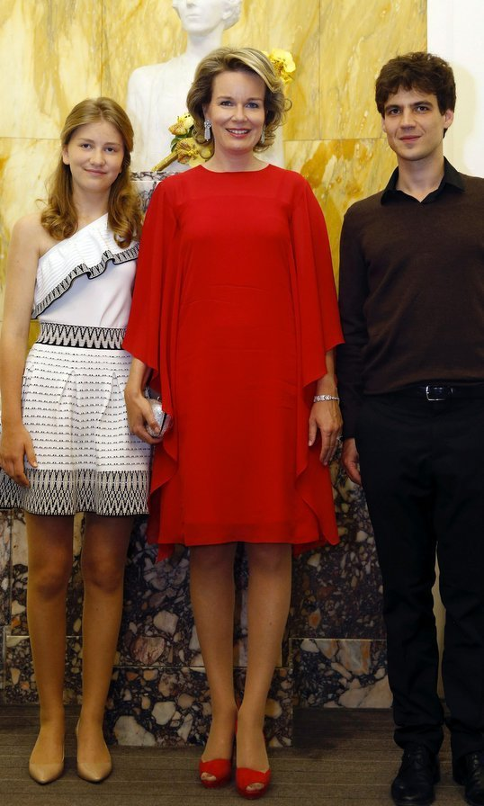 Head-to-toe red was a winner as Queen Mathilde of Belgium and her 15-year-old daughter Princess Elisabeth met with champion French cellist Victor Julien-Laferriere at a competition in Brussels.