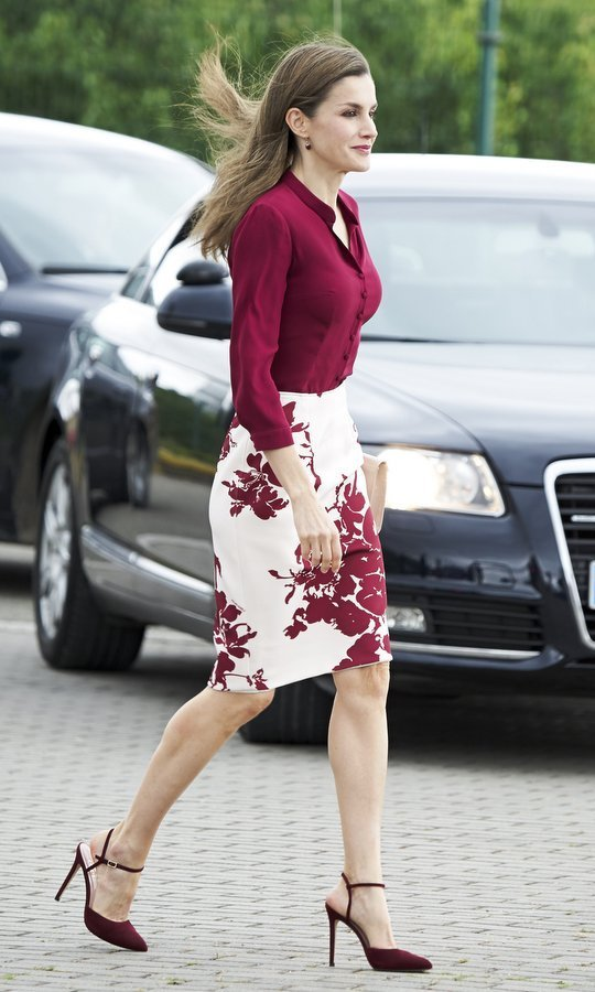 Burgundy is one of Queen Letizia's signature colours – and here's the Spanish royal stepping out in the rich shade during a visit to San Adrian, Spain.