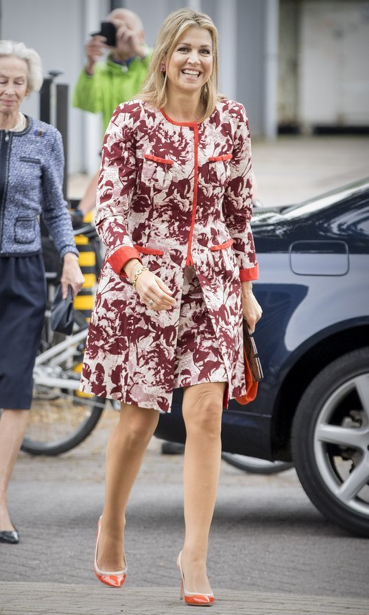 When it comes to bright hues, Queen Maxima of the Netherlands always comes through! The Dutch royal wore this matching printed coat and dress – given added pops of colour with her orange shoes, purse and trim! – at Tobroco Machines in Oisterwijk, Netherlands on June 8.
