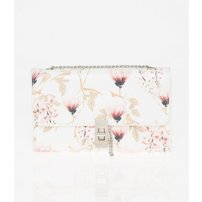 <strong>Floral Print Leather-Like Flapover Clutch</strong>, $40, <em>Le Château.</em>