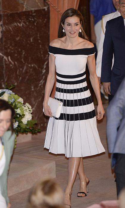 Queen Letizia bared her shoulders stepping out in the perfect summer at the 2017 UNICEF Spanish Committee Awards. The Spanish royal, who is known for favouring trendsetting styles, donned an off-the-shoulder midi dress by Carolina Herrera. The black and white striped knit number from the designer's spring 2017 collection features a pleated skirt and originally retailed for $2,500.