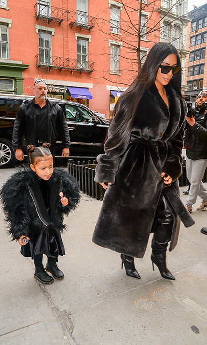 Earlier this year, North chased away the cold weather in New York wearing a black leather dress and furry coat. 